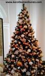 Een versierde kerstboom huren, bij u geleverd