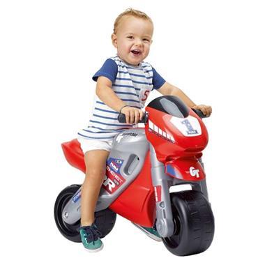 Grote foto feber loopmotor met helm kinderen en baby los speelgoed