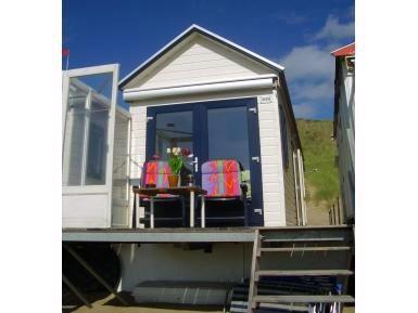 Grote foto slaapstrandhuisje strandhuisje slapen op strand vakantie nederland zuid