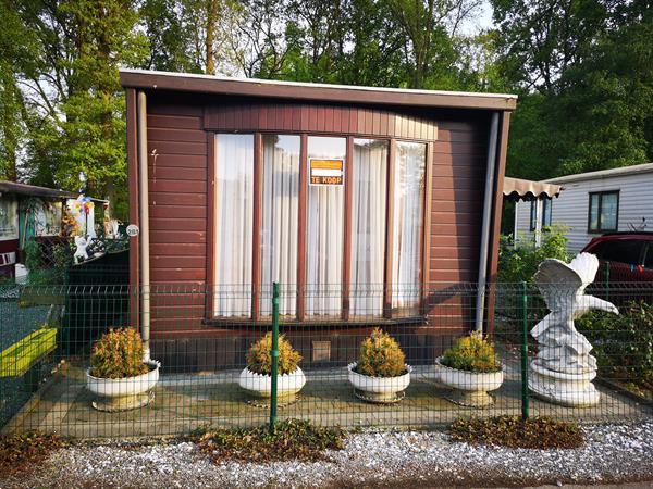 Grote foto winter en zomer chalet caravans en kamperen stacaravans